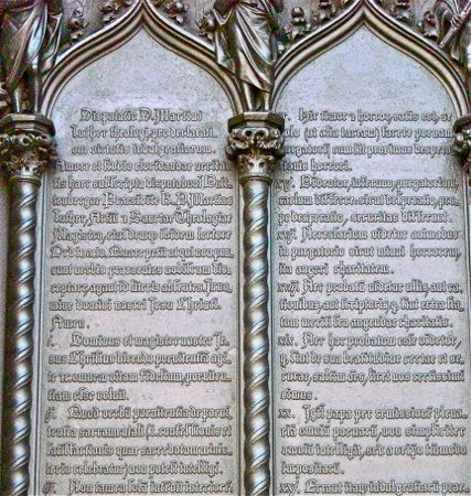 engraving of 95 theses, church doors, wittenberg, germany