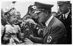 hitler receiving flowers from little girl, wachenfeld 1934
