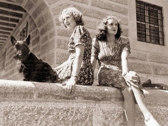 Eva and Gretl Braun sitting on ledge at the Eagles Nest