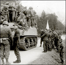 German soldiers surrendering to Americans in tank, on the road into Berchtesgaden