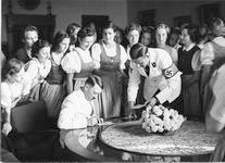 Hitler signing autographs for German League girls