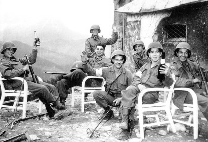 American soldiers celebrating with wine at Berghof