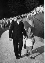 Hitler walking up the road near the Berghof with a little girl