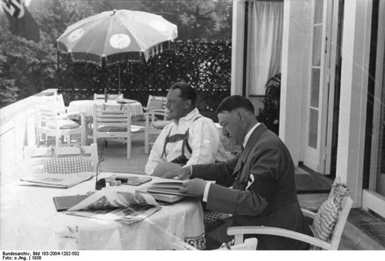 Hitler and Goering on terrace of Berghof, Hitler reading newpaper