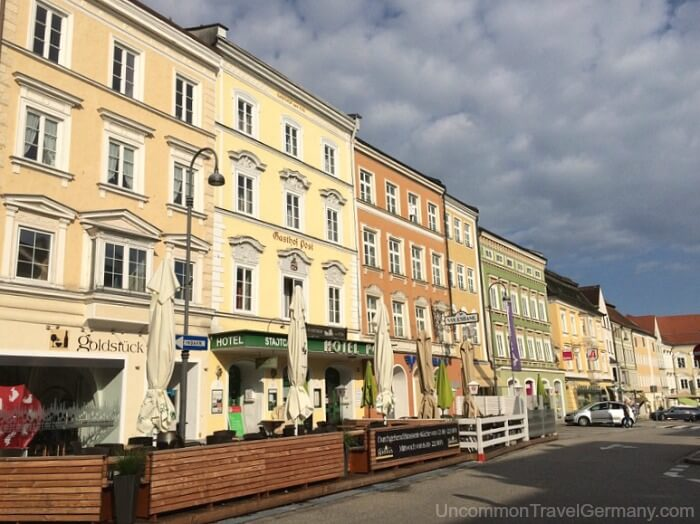 Pastel buildings on Stadtplatz in Braunau am Inn, Austria.