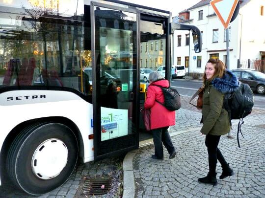 Woman getting on bus to Colditz in Grimma, Germany