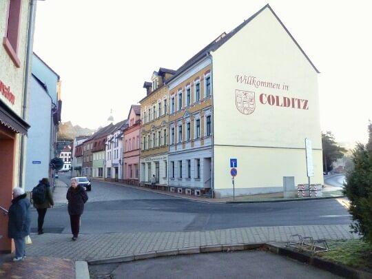 Street scene in Colditz, Germany, showing Wilkommen sign on building