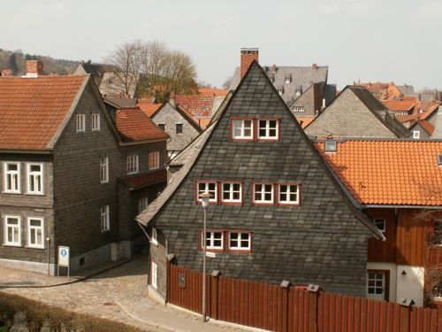 Street scene in Goslar, Harz, Germany, gray houses with red tiled roofs