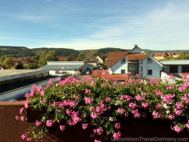Flowered balcony and view from Hotel Kaiser in Hammelburg Germany