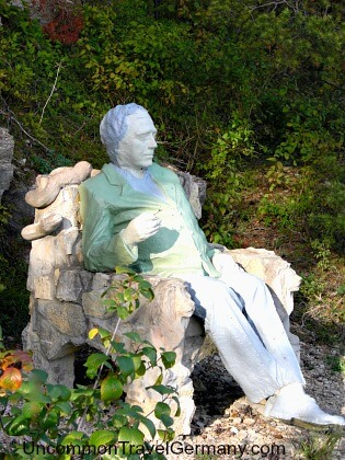 Mysterious statue of seated man outside Hammelburg