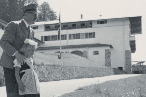 Hitler standing with little girl in Berghof driveway
