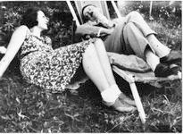 Hitler and Geli Raubal on grass