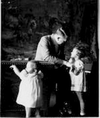 Hitler with little girl inside the Berghof