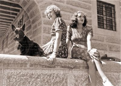 Eva Braun and her sister Gretl, sitting on the rear terrace at the Eagle's Nest