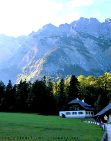 Alpine house and mountains at Lake Konigssee