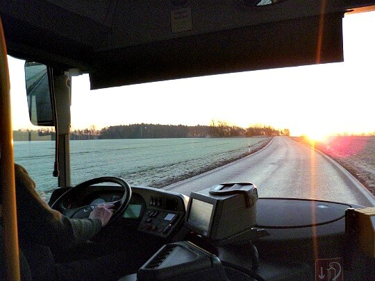 View through windshield of bus heading to Colditz, Germany, on winter morning