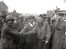 Freed American POW shaking hands, Stalag 13, 1945
