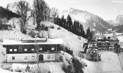 Old image of ruined Berghof and restored Hotel zum Turken in snow