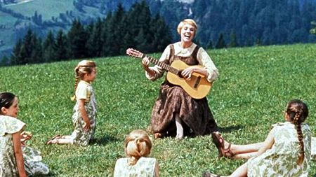 Maria singing with the Trapp children on the mountain