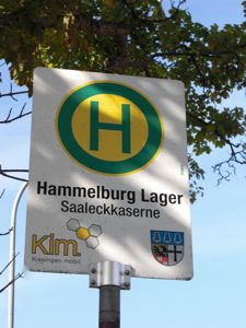 Bus stop sign showing stop for Lager Hammelburg