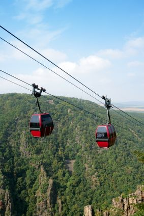 Red gondolas on the aerial tramway from Thale to the Hexentanzplatz, Harz Mountains, Germany