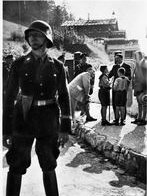SS soldier guarding Hitler greeting fans near Berghof