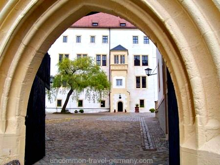 View of prisoners courtyard through archway, Colditz Castle