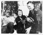 Eva Braun on Obersalzberg with two SS officers
