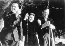 Eva Braun skiing with two SS officers