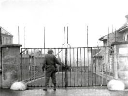US soldier at gates of Stalag 13, Germany, 1945