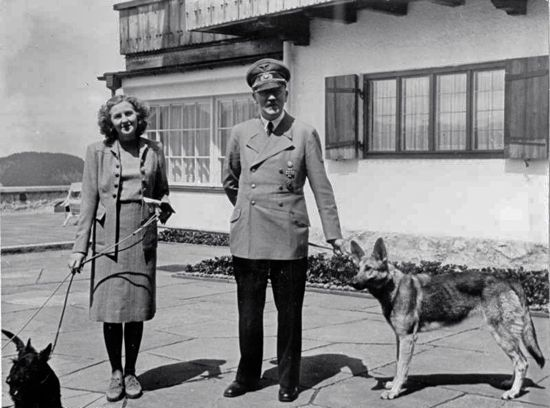 Hitler and Eva Braun on Berghof terrace with dogs