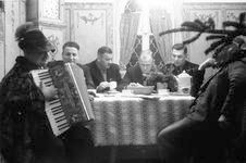 SS men listening to accordion at the Berghof