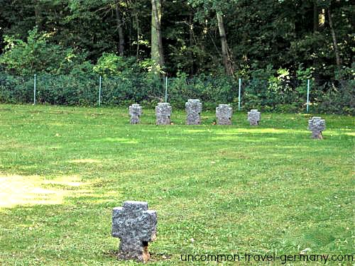 Graveyard in Lager Hammelburg with Russian headstones and crosses in a field.